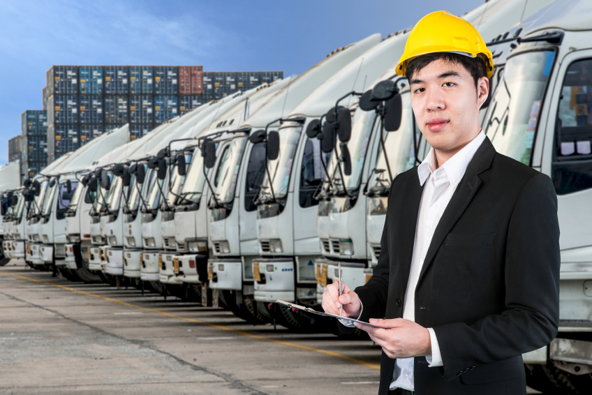Transportation engineer with trucks of a transporting company in