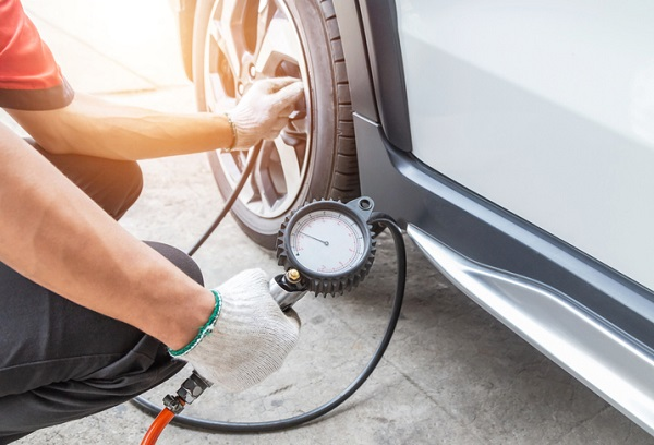 Regularly checking a car's tire pressure can help clients reduce their car's fuel use in the winter