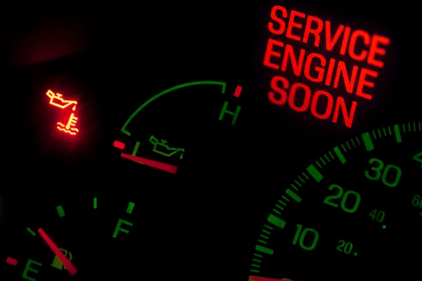 The check engine light being on is a sign that a vacuum leak may be present